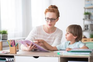 woman and boy tutoring