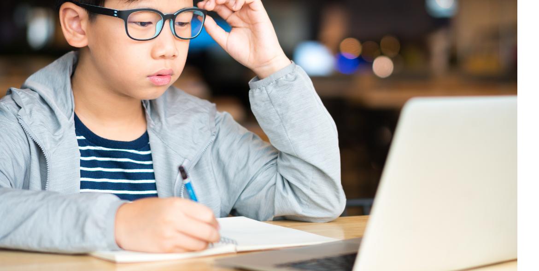 Boy Taking a Computerised Exam